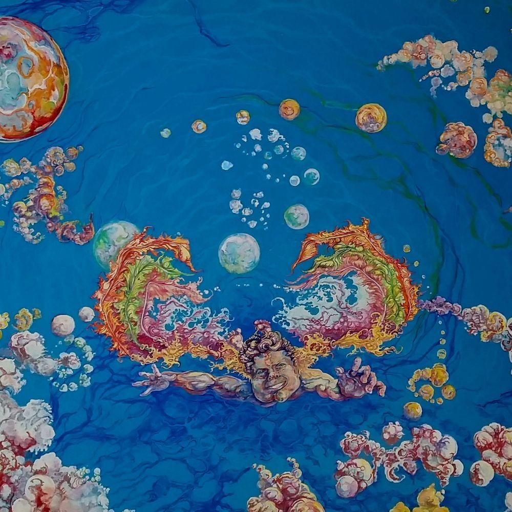 cherub in flight face hands water bubbles